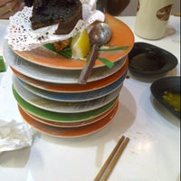 Photo taken at Sushi Train by Rebecca L. on 4/14/2012