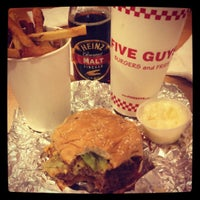 Photo taken at Five Guys by Candice D. on 3/25/2012