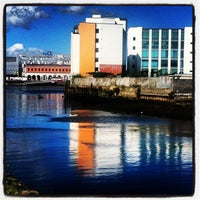 Photo taken at Grand Canal Dock by Claire M. on 8/18/2012