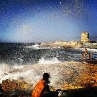 Photo taken at spiaggia Fenicia by Edoardo B. on 8/26/2012