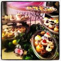 Photo taken at Tokens of My Confection Cupcakery by Jai on 2/19/2012