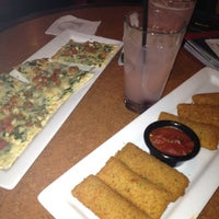 Photo taken at TGI Fridays by Jess H. on 4/5/2012