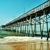 Photo taken at Oak Island Pier by Brian C. on 7/2/2012