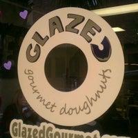 Photo taken at Glazed Gourmet Doughnuts by Jeni B. on 2/14/2012