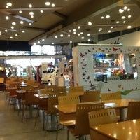Photo taken at Dinosaurio Mall by Alejandro R. on 7/25/2012
