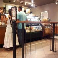 Photo taken at Starbucks by Guilherme Y. on 8/25/2012