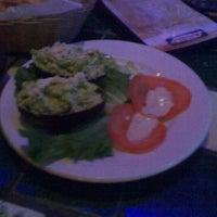 Photo taken at Orange Bar by Dara B. on 3/11/2012