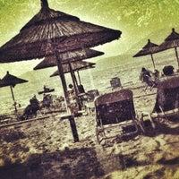 Photo taken at Bikini Beach Bar by Kostas N. on 8/8/2012