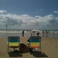 Photo taken at Mooloolaba Beach by Kirri K. on 4/5/2012