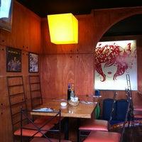 Photo taken at Ecléctico Bar & Restaurant by Rodrigo B. on 2/23/2012