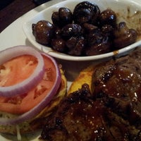 Photo taken at Firebirds Wood Fired Grill by Rony G. on 8/17/2012