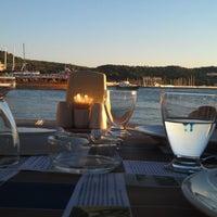 Photo taken at Ayvalık Canlı Balık Restaurant by Ali R K. on 8/20/2012