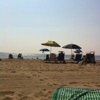 Photo taken at Belmar Beach by Sarah B. on 8/31/2012