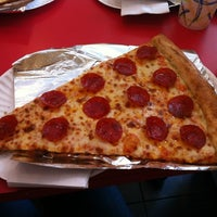 Photo taken at Jumbo Slice Pizza by Liz D. on 3/7/2012