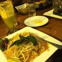 Photo taken at Wild Ginger Pan-Asian Vegan Cafe by Emily L. on 5/29/2012
