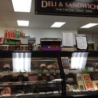 Photo taken at Mac's Market by Derek G. on 5/3/2012