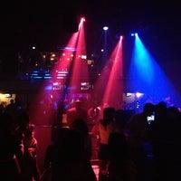 Photo taken at Status Lounge by Amanda V. on 4/8/2012
