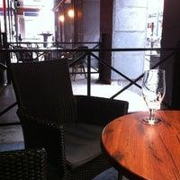 Photo taken at Hemingway's Bar & Cafe by Kia L. on 7/20/2012