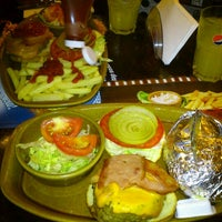 Photo taken at Foster's Hollywood by Pili B. on 8/1/2012