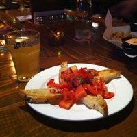 Photo taken at Ernie's Bar & Pizza by Ambur C. on 6/17/2012