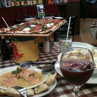 Photo taken at Buca Di Beppo by Ely B. on 7/12/2012