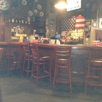 Photo taken at Dead Presidents Pub & Restaurant by Melanie on 7/26/2012