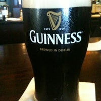 Photo taken at Tigín Irish Pub & Restaurant by 💀Robert P. on 5/12/2012