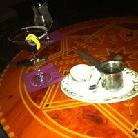 Photo taken at Paymon's Mediterranean Cafe & Hookah Lounge by Juan L. on 5/3/2012