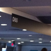 Photo taken at Gate D60 by Raul G. on 5/25/2012