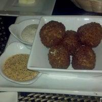 Photo taken at Noir Food & Wine by Jennifer N. on 7/8/2012