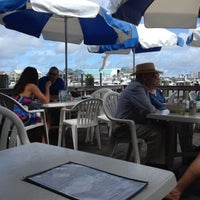 Photo taken at Dockside Restaurant & Bar by Jessica K. on 8/4/2012