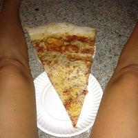 Foto diambil di Jumbo Slice Pizza oleh Carolyn S. pada 9/1/2012