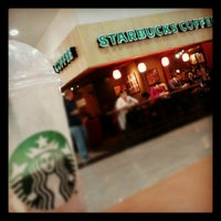 Photo taken at Starbucks by Marcos V. on 5/24/2012