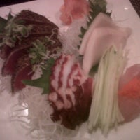 Photo taken at Roppongi Sushi Restaurant by Fernanda D. on 7/28/2012