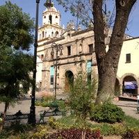 Photo taken at Jardín Hidalgo by Alex C. on 2/23/2012