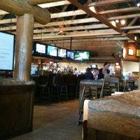 Photo taken at Smokey Bones Bar & Fire Grill by John W. on 5/27/2012