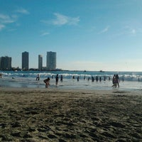 Photo taken at Playa Cavancha by Victor P. on 2/24/2012
