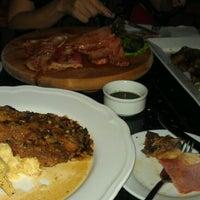 Photo taken at Euros Bar & Dine by Kong Chun L. on 9/6/2012