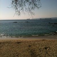 Photo taken at Playa Las Conchitas by Fernanda on 7/11/2012