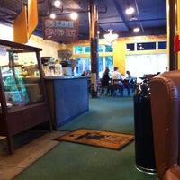 Photo taken at Uptown Espresso by Glaucio S. on 5/28/2012
