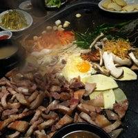 Photo taken at 제주오겹살 왕돌구이집 by 다동동동 on 2/26/2012