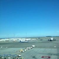 Photo taken at Gate A7 by Soichiro T. on 7/28/2012