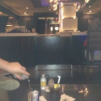 Photo taken at Seven Stars Lounge by Moses C. on 9/9/2012
