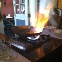 Photo taken at Ralph Brennan's Jazz Kitchen by Laura B. on 5/21/2012