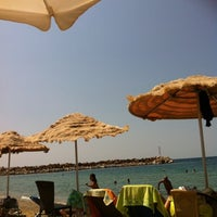 Photo taken at BeBa beach bar by Δέσποινα Κ. on 8/19/2012
