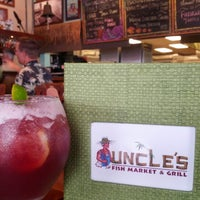 Photo taken at Uncle's Fish Market & Grill by Jeffrey V. on 8/2/2012