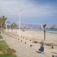 Photo taken at Playa Cavancha by Jaime V. on 8/29/2012