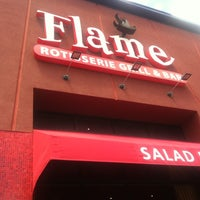 Photo taken at Flame Rotisserie Grill & Bar by Tabi H. on 6/21/2012