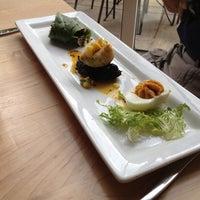 Photo taken at Leaf Vegetarian Restaurant by Megan B. on 7/28/2012
