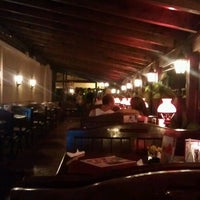 Photo taken at City Grill by Cosmin E. on 7/13/2012